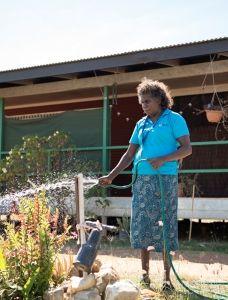 Lady watering her garden
